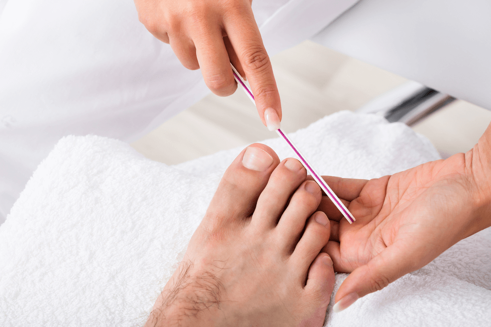 male pedicure with polish